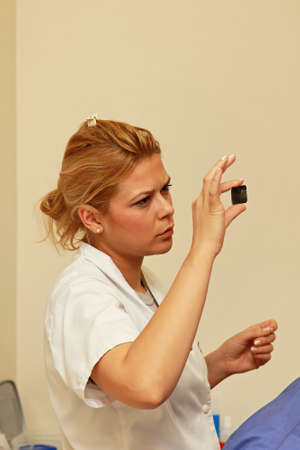 Dentist looking at X ray tooth scan photo