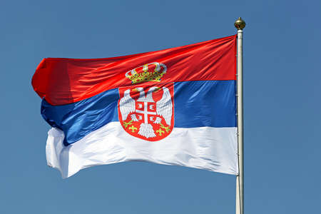 Serbian national flag tricolour with eagles and crown photo