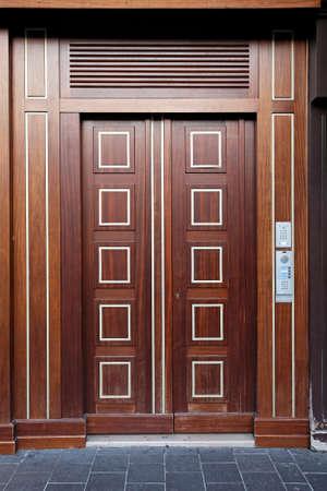 large doors: Double wooden door luxury entrance in building