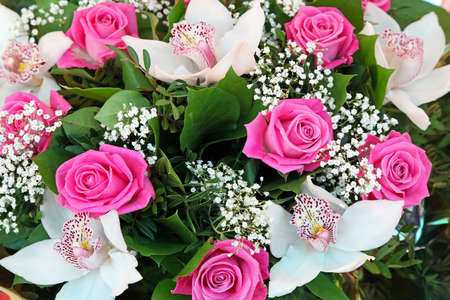 phalaenopsis: Pink roses and white orchid flowers bouquet
