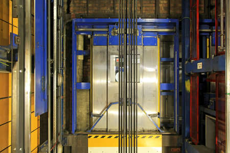 shaft: Modern elevator shaft interior with cables and tracks
