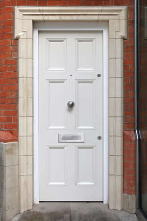 entrance door: White entrance door at traditional English house Stock Photo