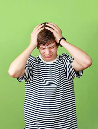 Teenage boy with headache holds head with hands Stock Photo - 14664132