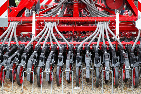 planter: Red seeder planter row machine for agriculture Stock Photo