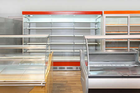 empty shelf: Empty retail shelves and showcases in grocery store