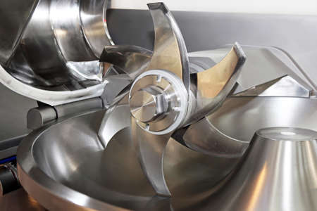 slaughter: Sharp rotary knife in slaughter house machine Stock Photo