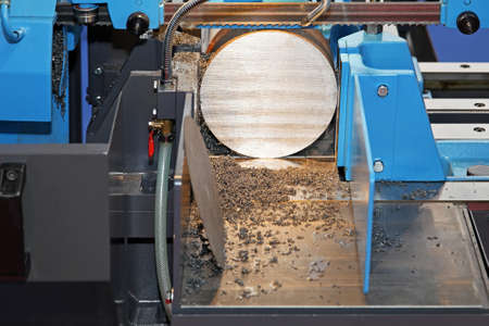 saws: Automatic metal cutting band saw powerful machine Stock Photo