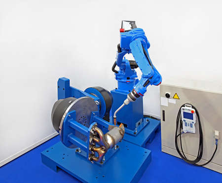 car manufacturing: Robot welder manufacturing car parts in factory Stock Photo