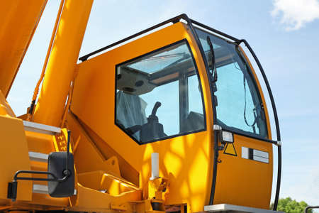 machinery and equipment: Yellow safety cabin for construction crane operator Stock Photo