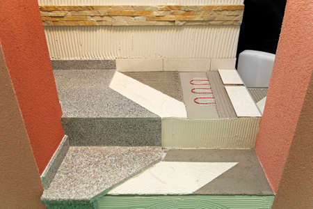 tile flooring: Floor heating system and new tiles renovations Stock Photo