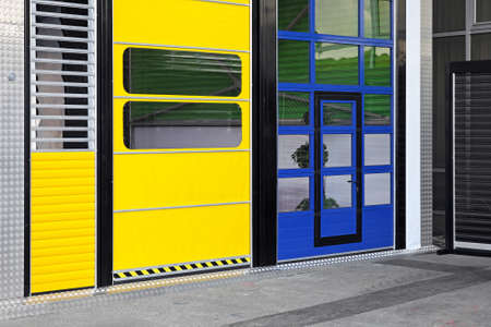 Tall doors at distribution warehouse building photo