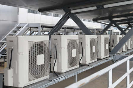 conditioner: Air conditioners condenser units at building rooftop