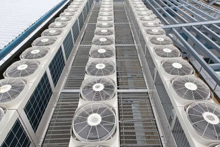 cooling: Central air conditioners condenser units at building rooftop Stock Photo