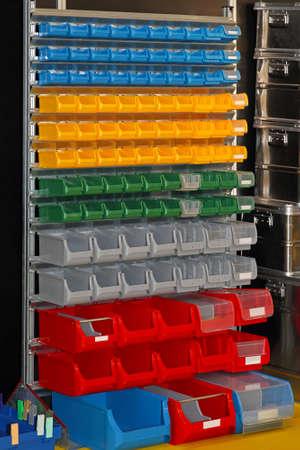 Colourful plastic bin trays at open shelf photo