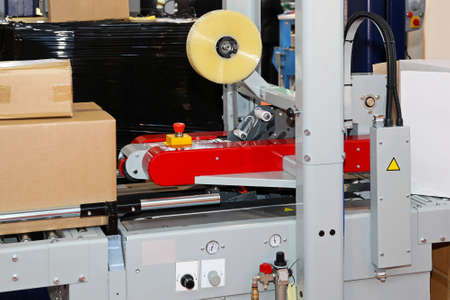 Automated packing and labeling machine for boxes photo