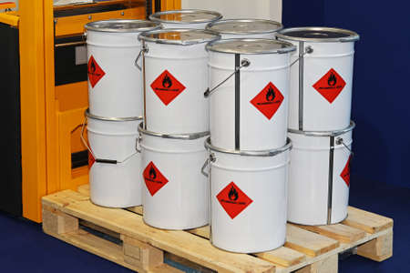 flammable: Flammable liquid in containers at pallet forklift Stock Photo