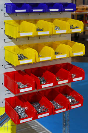 Colourful plastic sorting bins with nuts and bolts photo