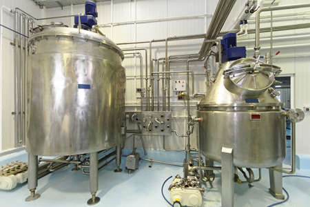 fermentation: Interior of dairy factory with fermentation tank Stock Photo