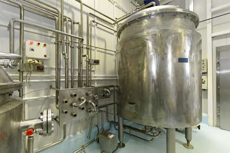 fermentation: Dairy factory with milk pasteurization tank and pipes