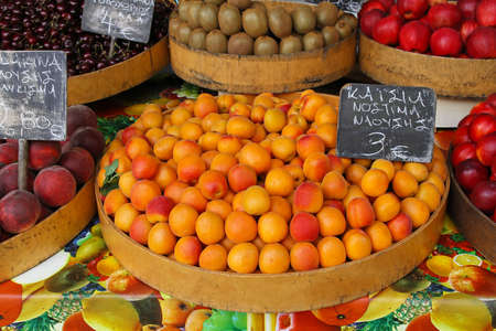 Bunch of apricots at farmers market stall Stock Photo - 15141039