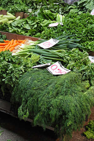 Big bunch of green vegetables at farmers market photo