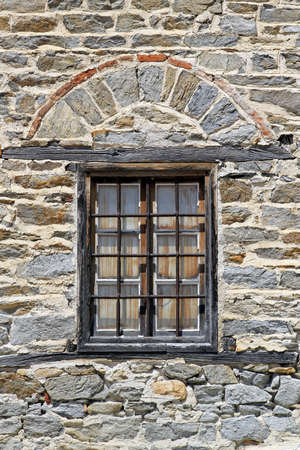 Window with bars at medieval Ouranopoli castle Stock Photo - 15141146