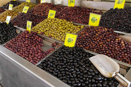 Bunch of various olives at market stall Stock Photo - 15141131