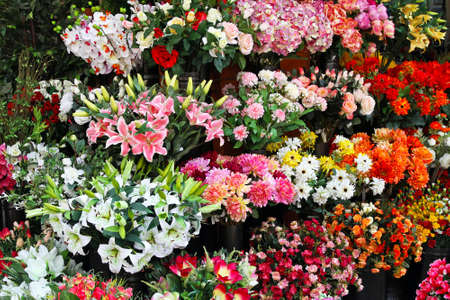 Bouquets of artificial flowers in flower shop