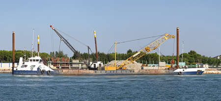 Barge crane at construction site in Venetian lagoon Stock Photo - 15174481