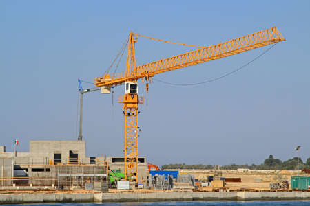 Crane at seawall construction in Venetian lagoon Stock Photo - 15174441