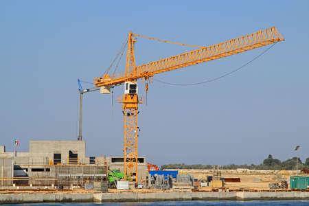 Crane at seawall construction in Venetian lagoon Stock Photo - 15174441