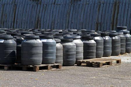 Industrial waiste in plastic barrels near warehouse Stock Photo - 15494669