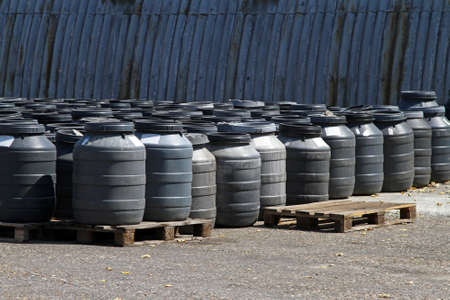 Industrial waiste in plastic barrels near warehouse Stock Photo - 15494669