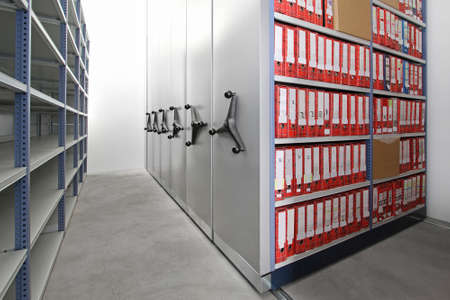 Company documents in ring binders at storehouse racks Stock Photo - 15494668
