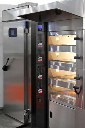 proffessional: Digital four level oven in big bakery