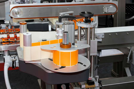 Automated labeling machine equipment with conveyor belt Stock Photo
