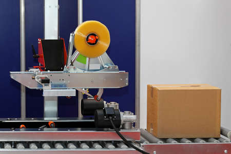 Automated packaging machine for boxes at factory Stock Photo - 15548823
