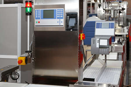 Modern packaging machine at production line in factory photo