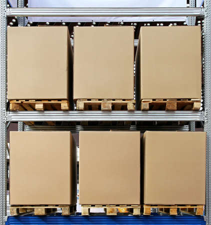 storage box: Carboard boxes with pallets in distribution warehouse