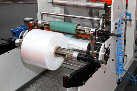 Printing and packing machine from plastic roll Stock Photo