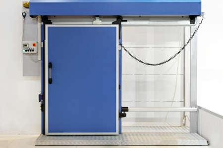 Automated insulated blue door at reefer refrigerator photo