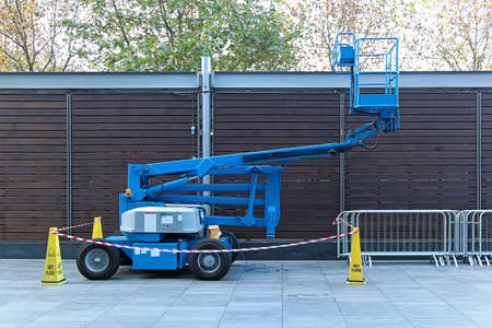 Self propeled blue telescopic boom lift platform photo
