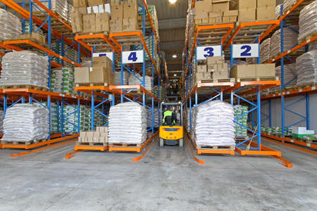Big warehouse interior with forklift in row Stock Photo - 15785444