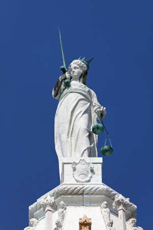 Lady Justice at rooftop of Palazzo Ducale Venice photo