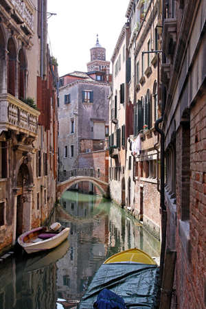waterway: Narrow canal with pedestrian bridge in Venice Stock Photo