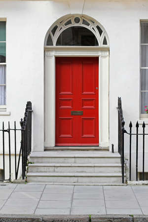 Residential house doorway with red wooden door photo