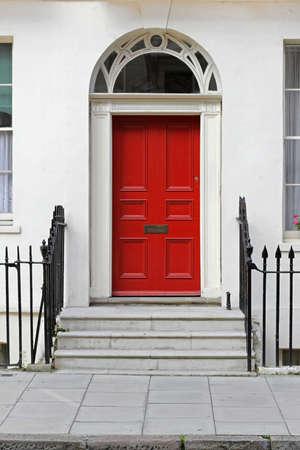 red door: Residential house doorway with red wooden door