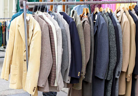 Second hand retro suits and jackets at rail photo