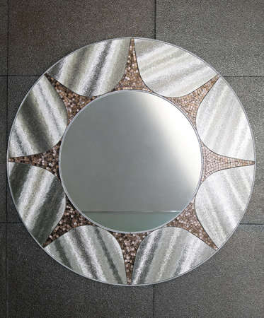 Round silver mirror at bathroom wall Stock Photo - 16127013