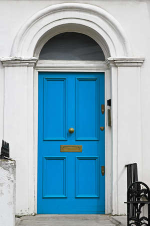 Blue entrance door on house with arch Stock Photo - 16127025